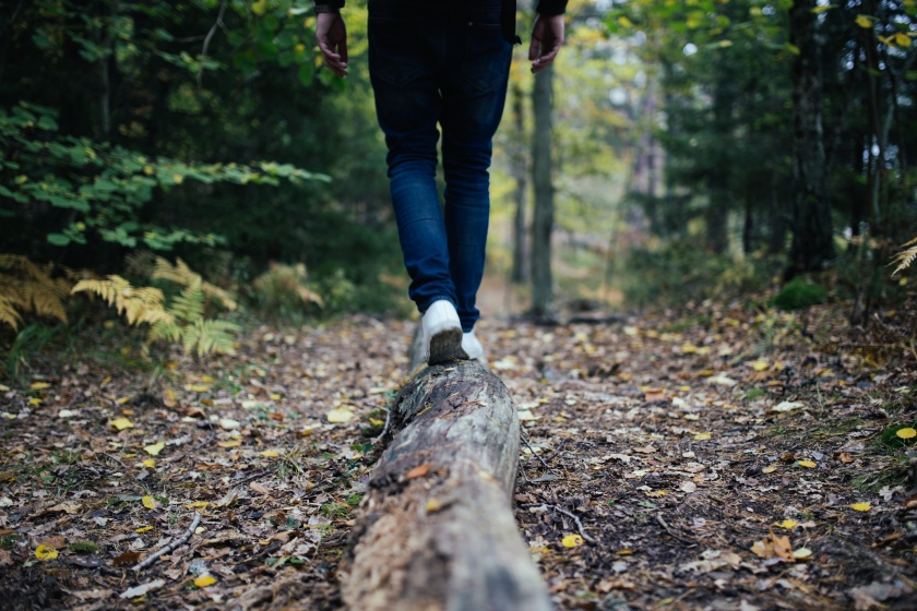unsplash hiking legs on wooded trail