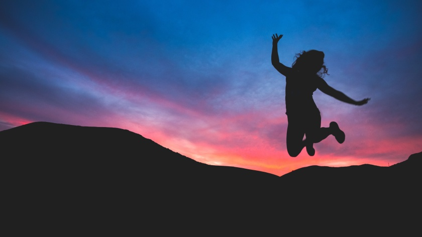 jumping with sunset unsplash