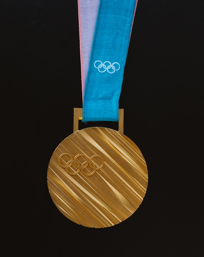 photo-1511406471420-feeac25c74c7 unsplash olympic gold metal